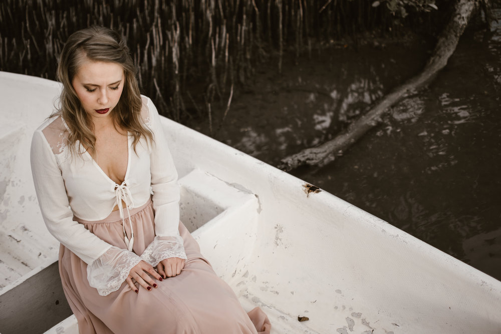portrait of model in boat in south florida by katie decker photography