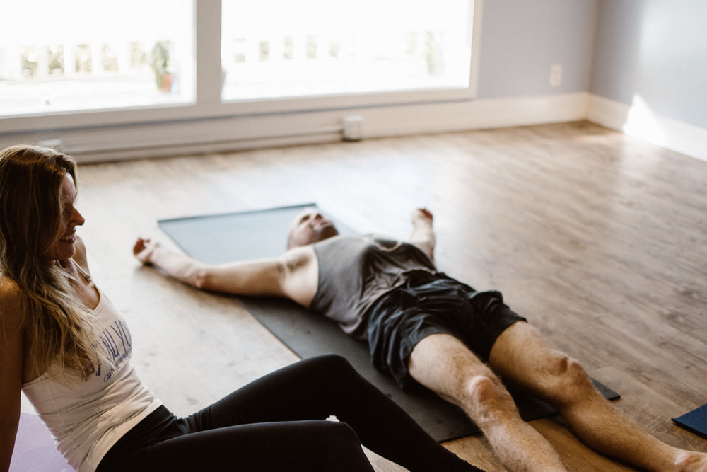 man relaxes exhausted after yoga class