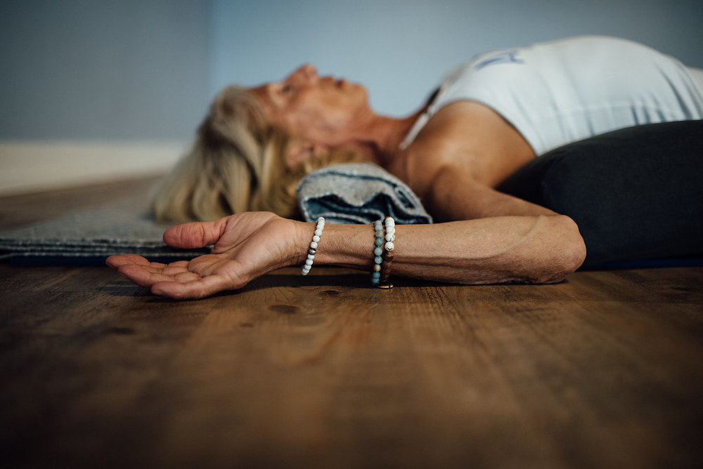 woman in restful yoga pose
