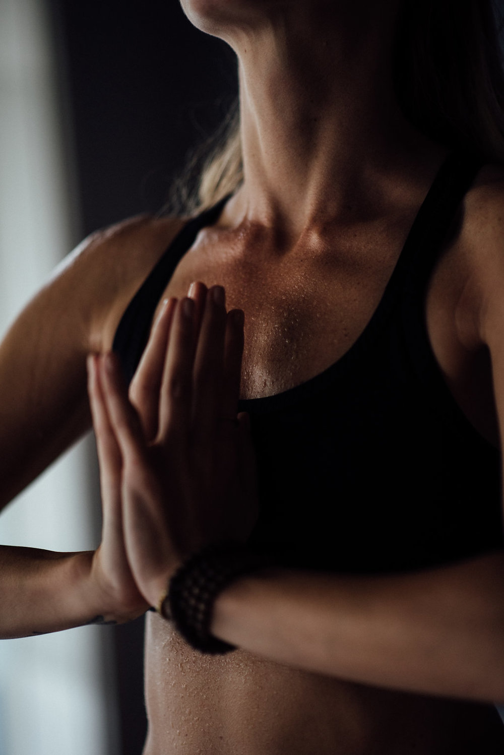 sweat beads on yoga student during hot yoga