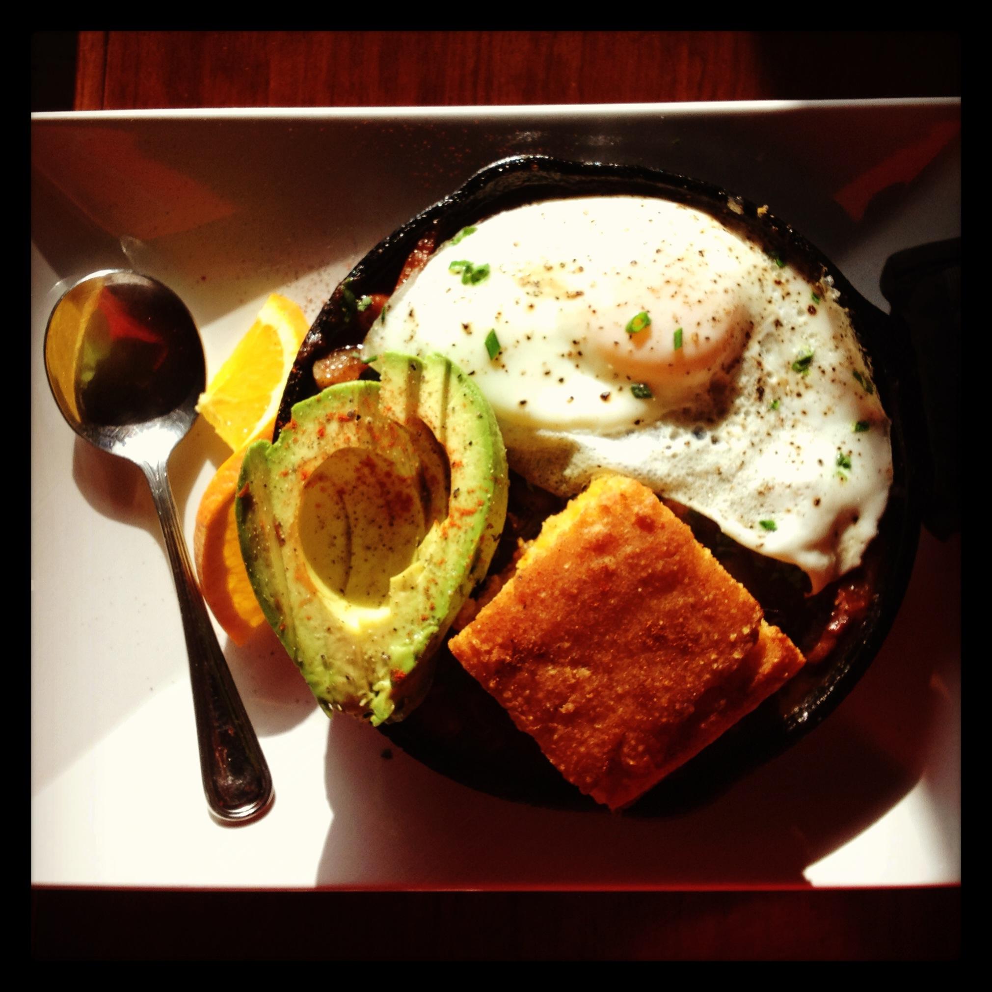 Delicious breakfast of chilli, fried egg, and cornbread at
