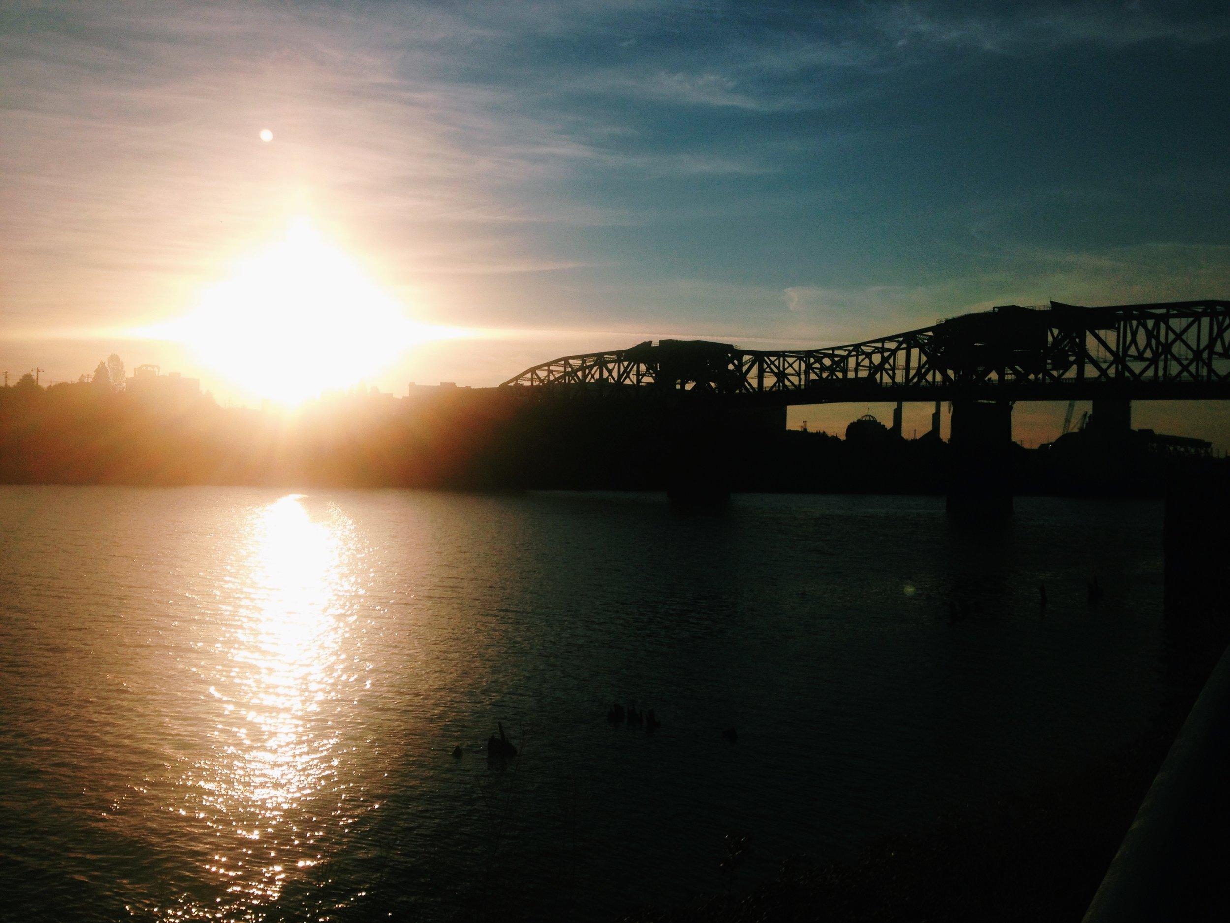 Broadway Bridge as the sun rises over the Wilamette.