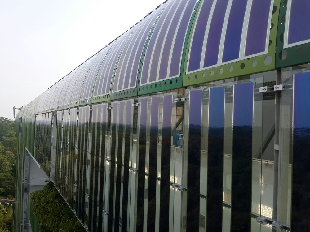 Organic solar photovoltaic (OPV) panels mounted on building