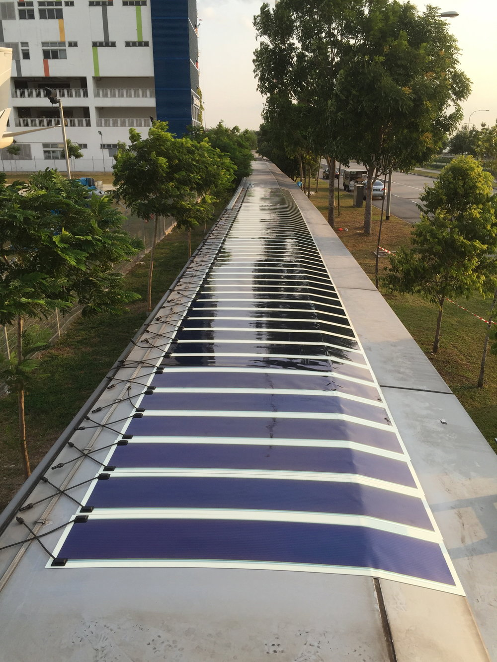Organic solar photovoltaic (OPV) panels mounted on shelter