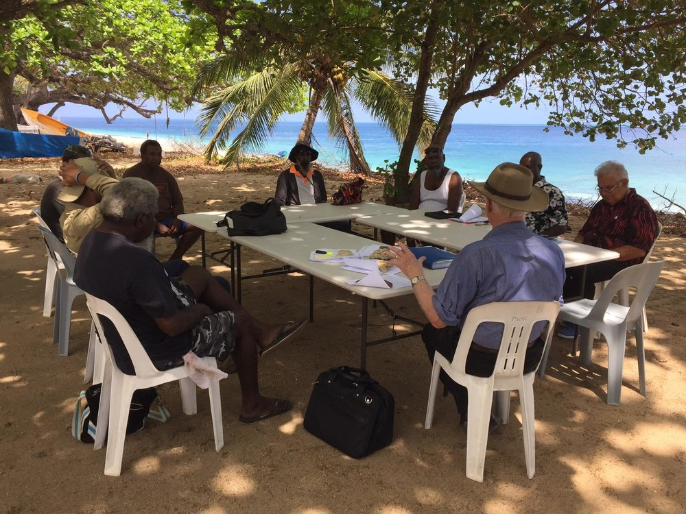 The most wonderful board room in the world!  Lindsay McDowell and Kimberley man Rodney Rivers with Elders on Mer (Murray) Island in the Torres Strait      (Photo courtesy David Way)