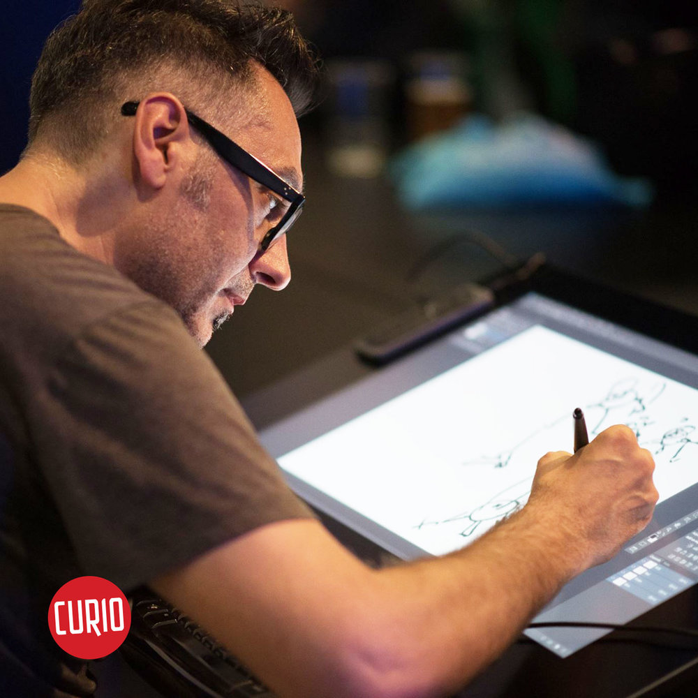 Cesare Asaro of Curio & Co. drawing on Cintiq at Pixel Vienna 2017