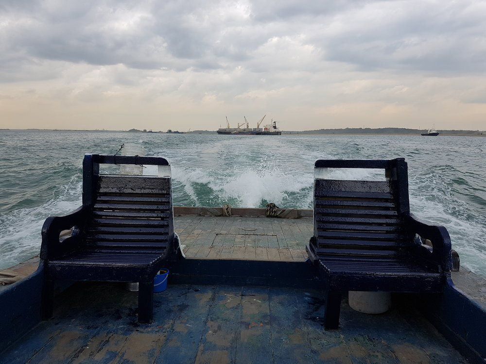 WE BELIEVE IN WORKING SIDE BY SIDE WITH OUR CLIENTS, LIKE THESE TWIN PAIR OF CHAIRS ON A TUGBOAT, WATCHING A BULK CARRIER DISAPPEAR INTO THE HORIZON