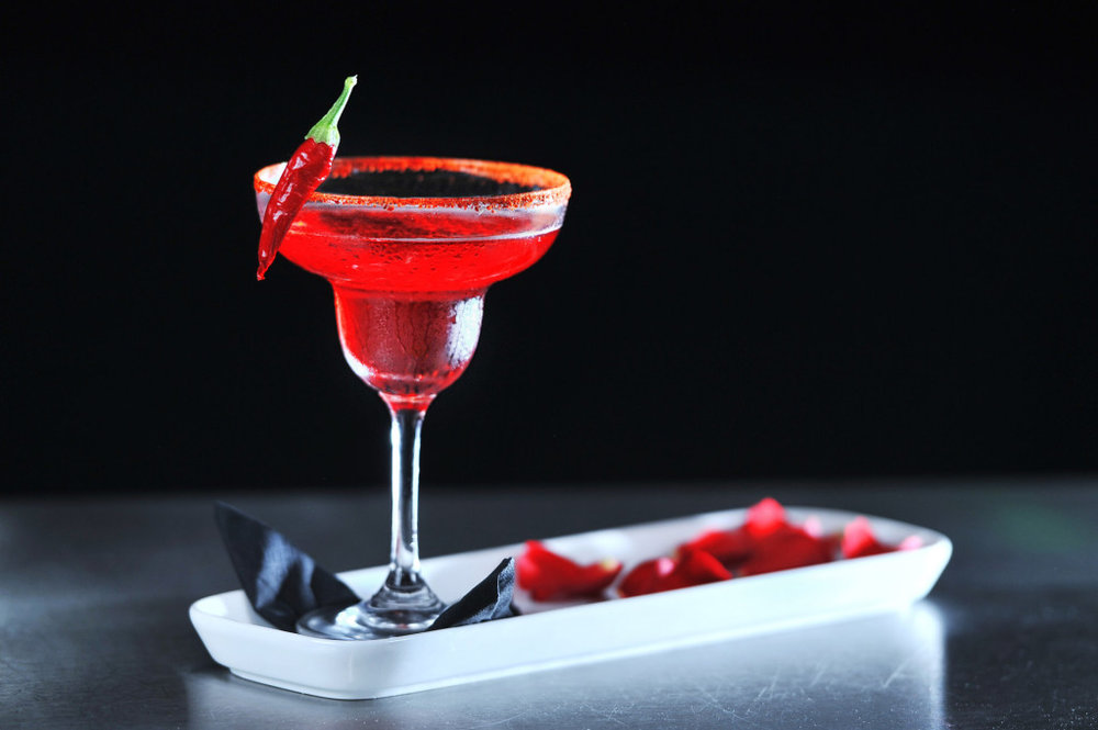 Red Hot Chilli Gentle; a mix of fresh strawberries, mint, lime, tabasco, agostura shaken with strawberry syrup and topped with Cava.