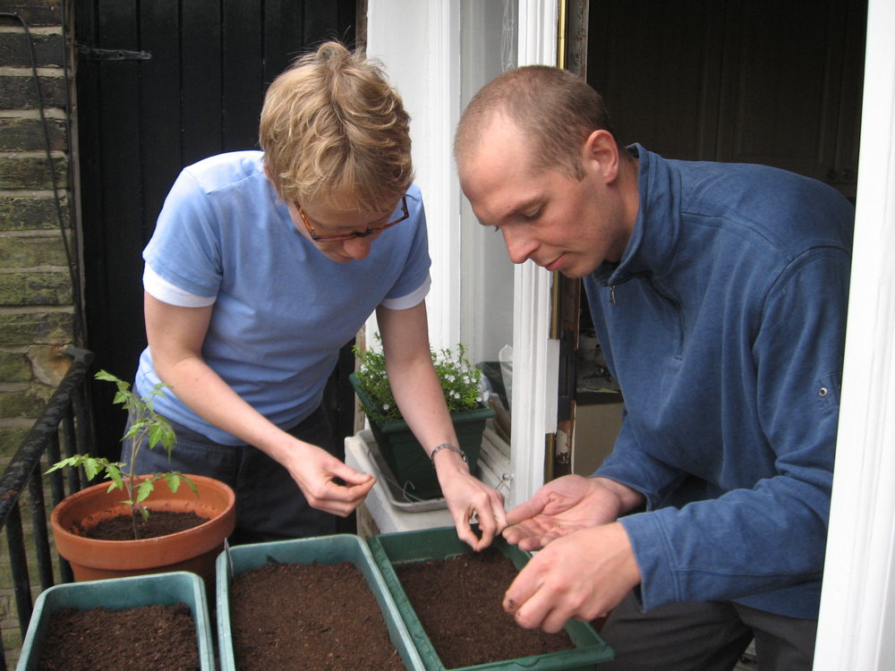 Sowing seeds with one of the first members.