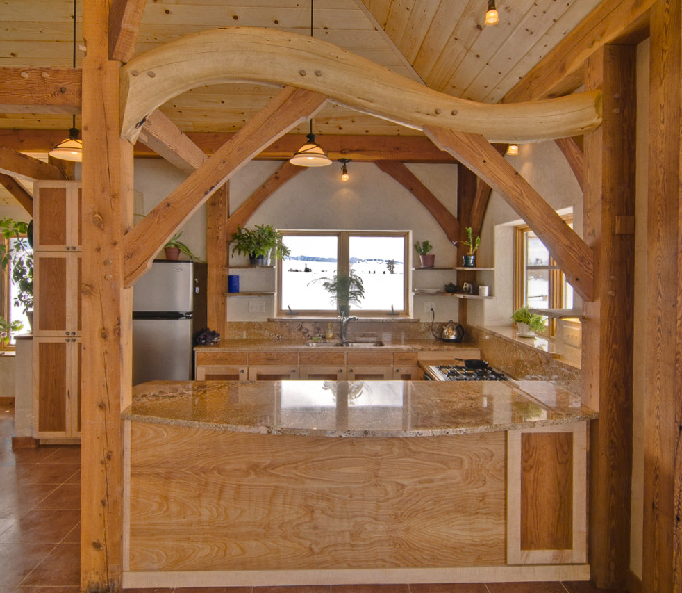 Taiko beam, reclaimed fir timbers and clay-straw walls in an Econest home, Moose, WY.