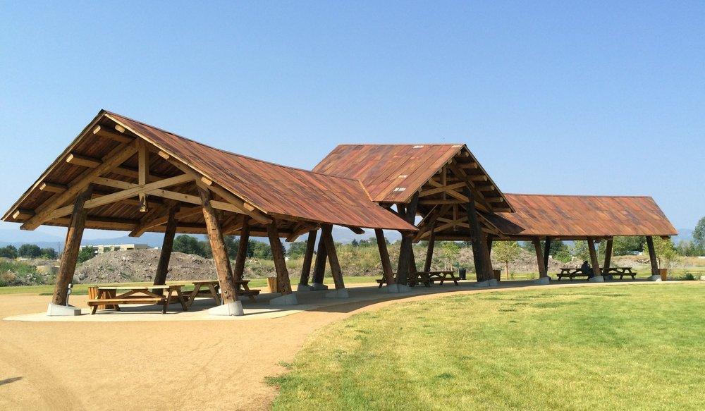 Silver Park pavilion, Missoula, MT, built with reclaimed logs, timbers, decking AND roofing from the old sawmill on the property.