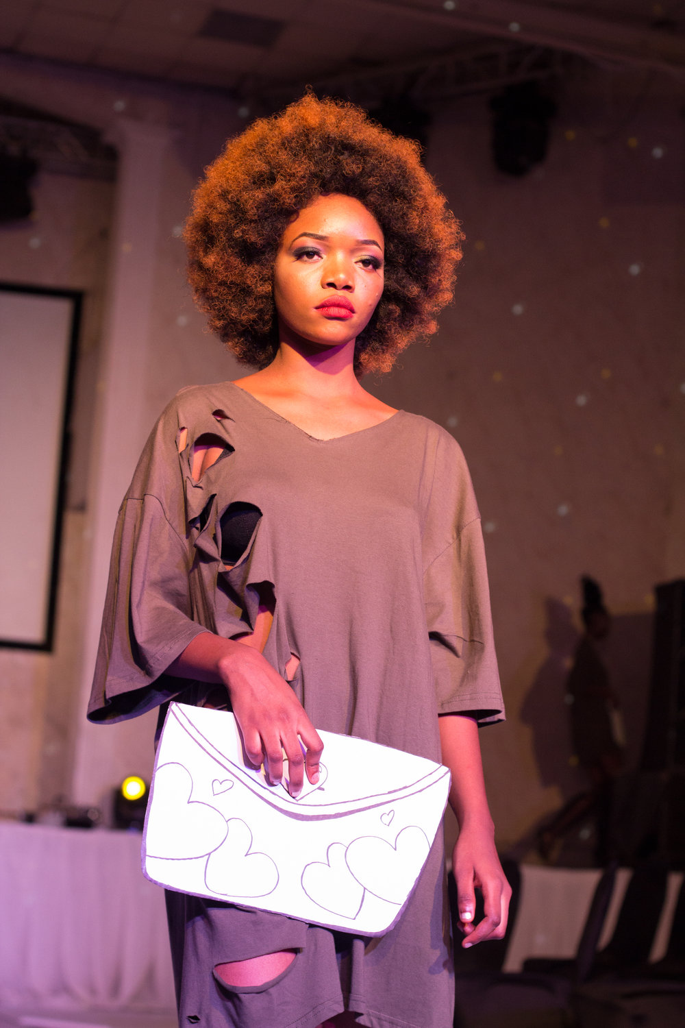 Nigerian Model in Pre-Show @ The Eleventh Fashion Show wearing VonRay Designs Distressed Tee Dress and Paper-doll bag Illustrated by Dennis Robinson II of D2Artz & VonRay Designs; PHOTOGRAPHER- Ebiye Wilson Jeke of Wilson Photography (@wilsonjekephotography)
