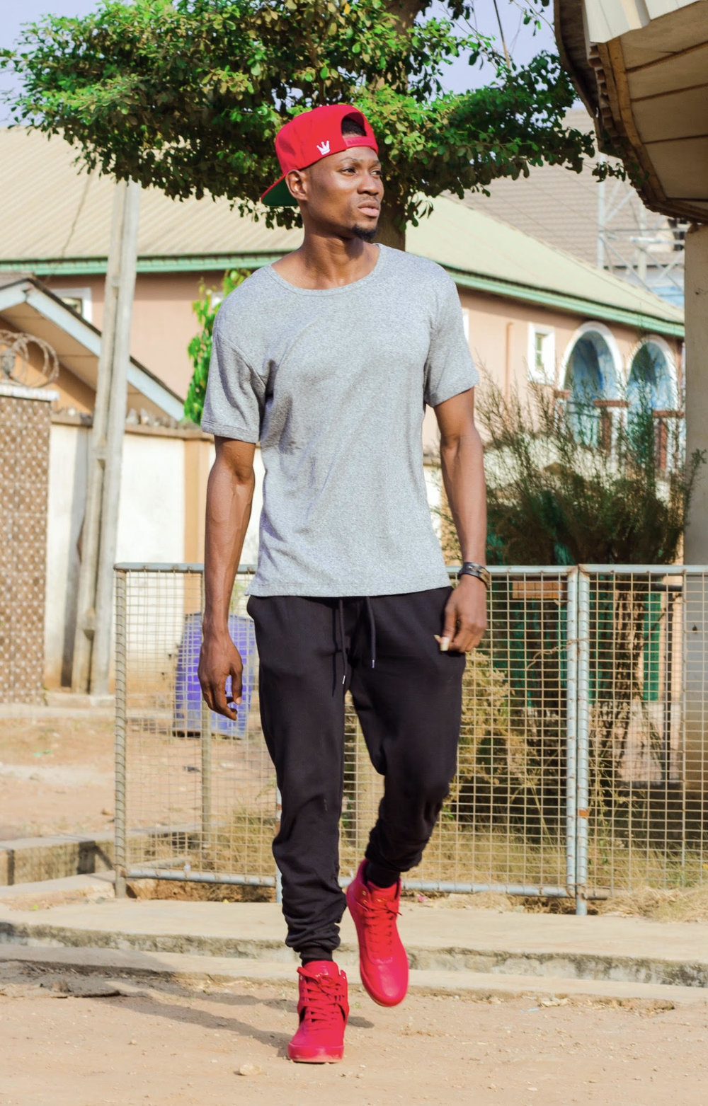 6coJohn  for  Heed Magazine ::    Wearing H&M Relaxed Tee & Joggers, paired with RED Creative Recreation Shoes and KMD Clothing Cap   Photographer:  Ebiye Wilson Jeke