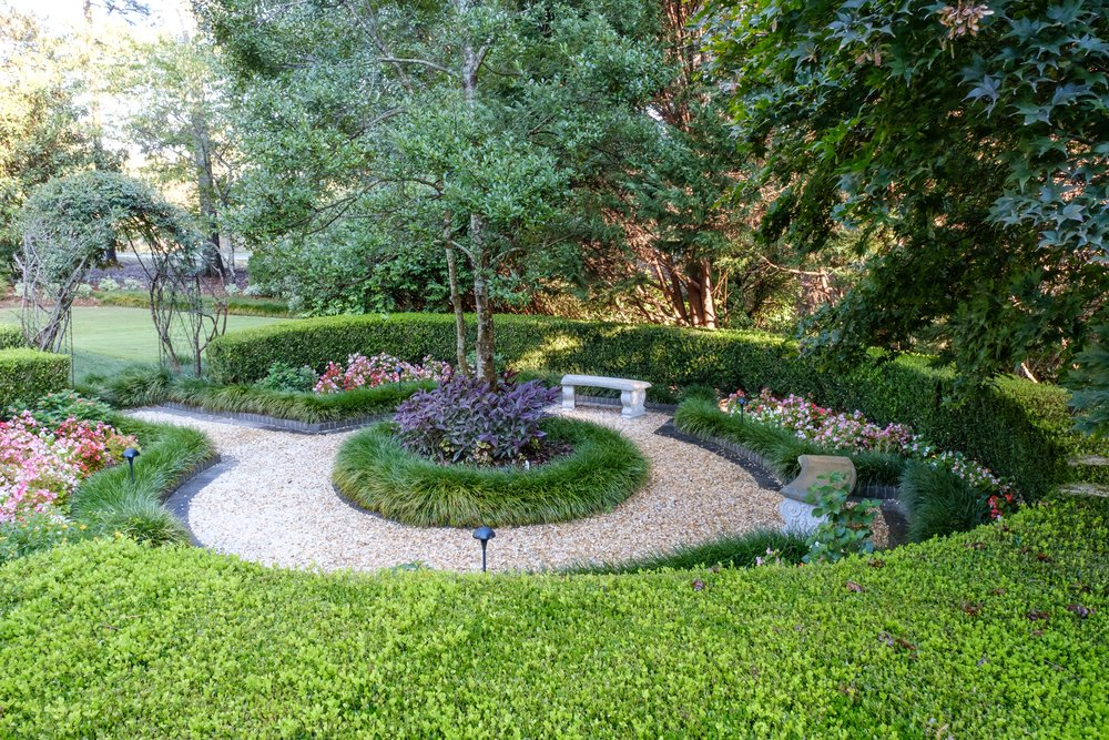 Round hedge landscaping installation