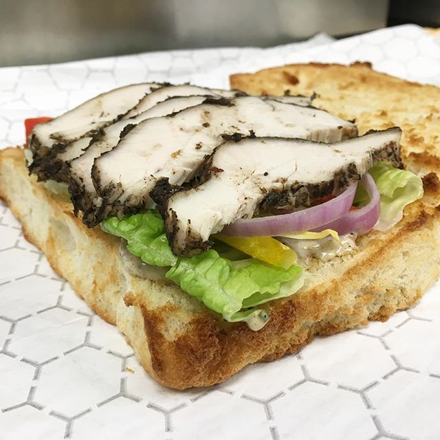 Introducing our #jerkchicken sandwich with #cocobread! You won't be able to let your hands off this delicious sandwich!