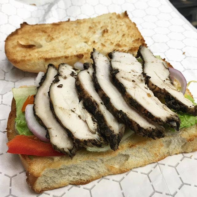 Tired of the same old sandwiches? Look no further! Come try our #jerkchicken sandwich with #cocobread! A bit of heat and a whole lot of deliciousness 😋