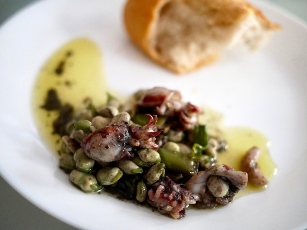 Baby squid, favas, green garlic on plate