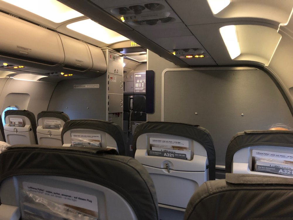 "Can you spot the ""Lufthansa Business Class"" placard on the bulkhead?"