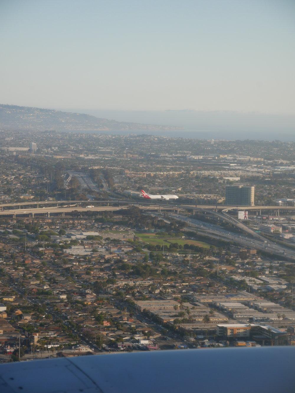 United premium transcontinental Economy landing LAX