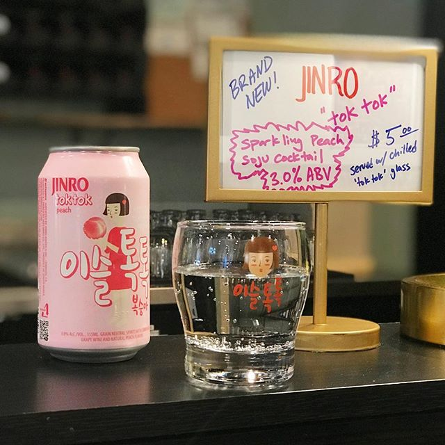 Now featuring a new Jinro sparkling peach mixed soju cocktail in a can!  Grab a cold one of these at art major with these adorable little branded glasses #Jinro #Toktok #drinkoftheday