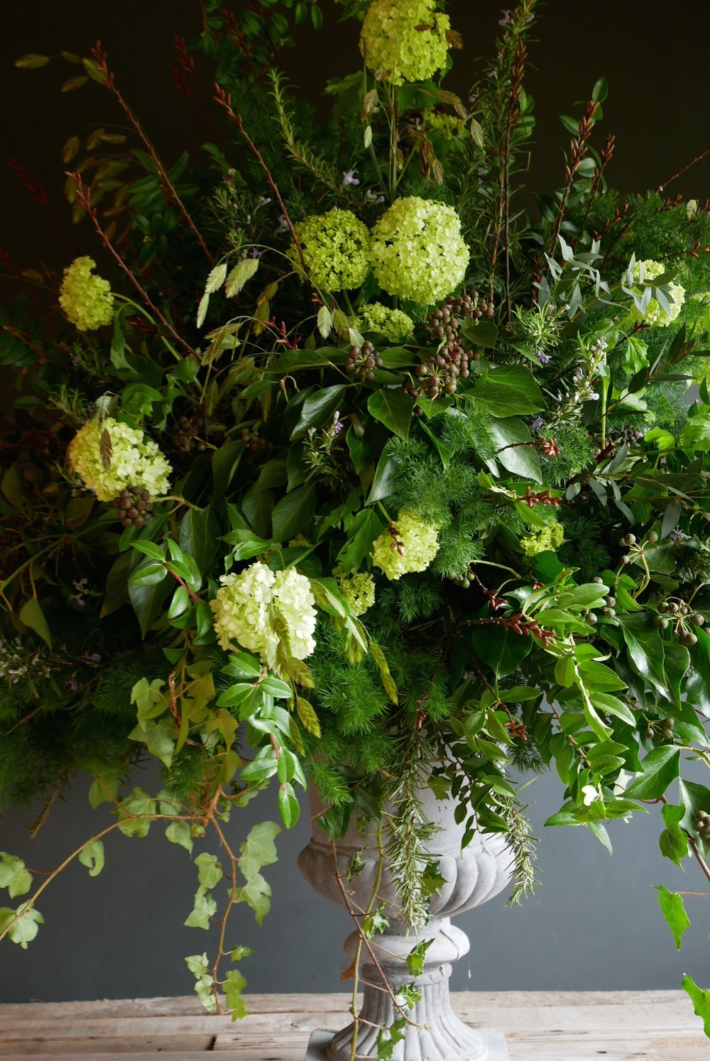 Large urn piece full of foliage, herbs and viburnum