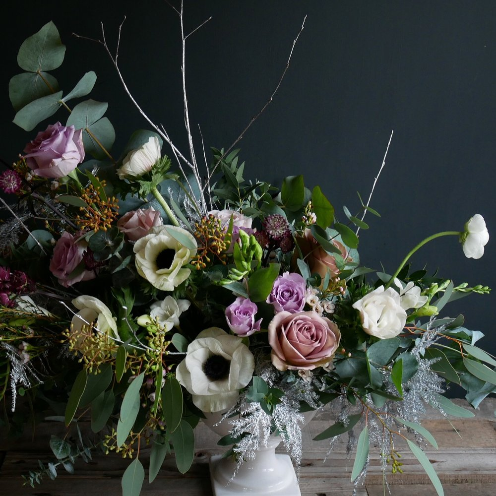 Compote design full of anemones, roses, ranunculus, foliage and ferns
