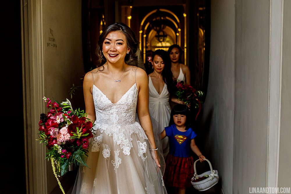 The Flower Story bride heads to her wedding ceremony at Aynhoe Park. Wedding bouquet is full of peonies, roses, orchids and foliage