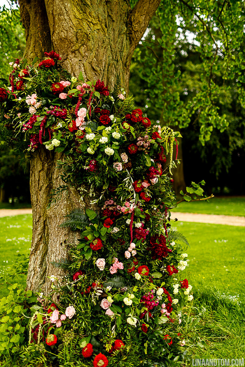 Large tree with cascade of flowers ready for wedding ceremony at Aynhoe Park