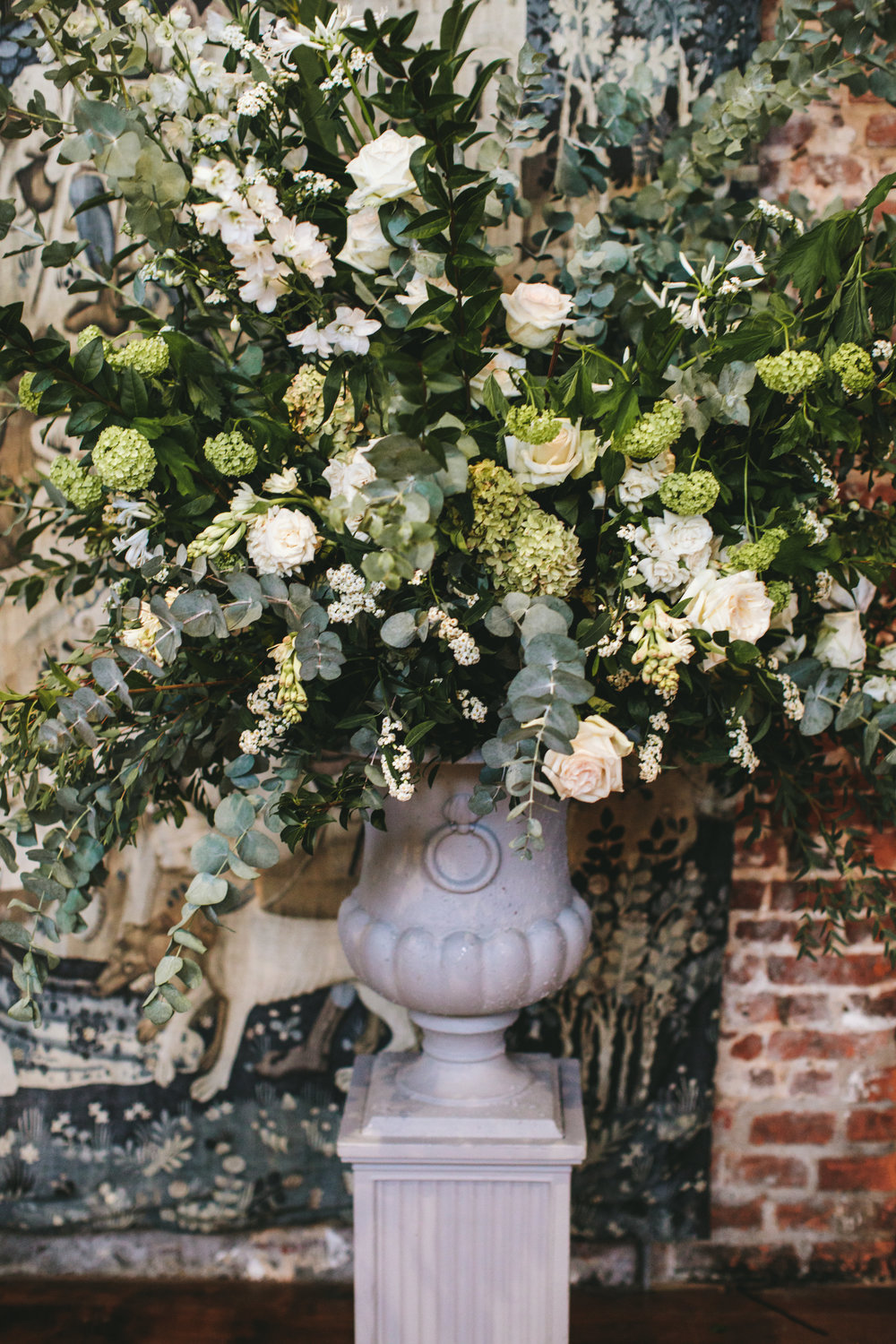 Large elegant green and white flower urn for Hatfield House wedding by The Flower Story