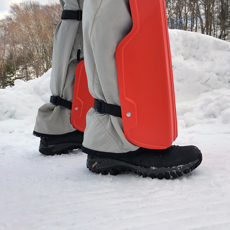 Flexible straps hold sleds snuggly to your legs