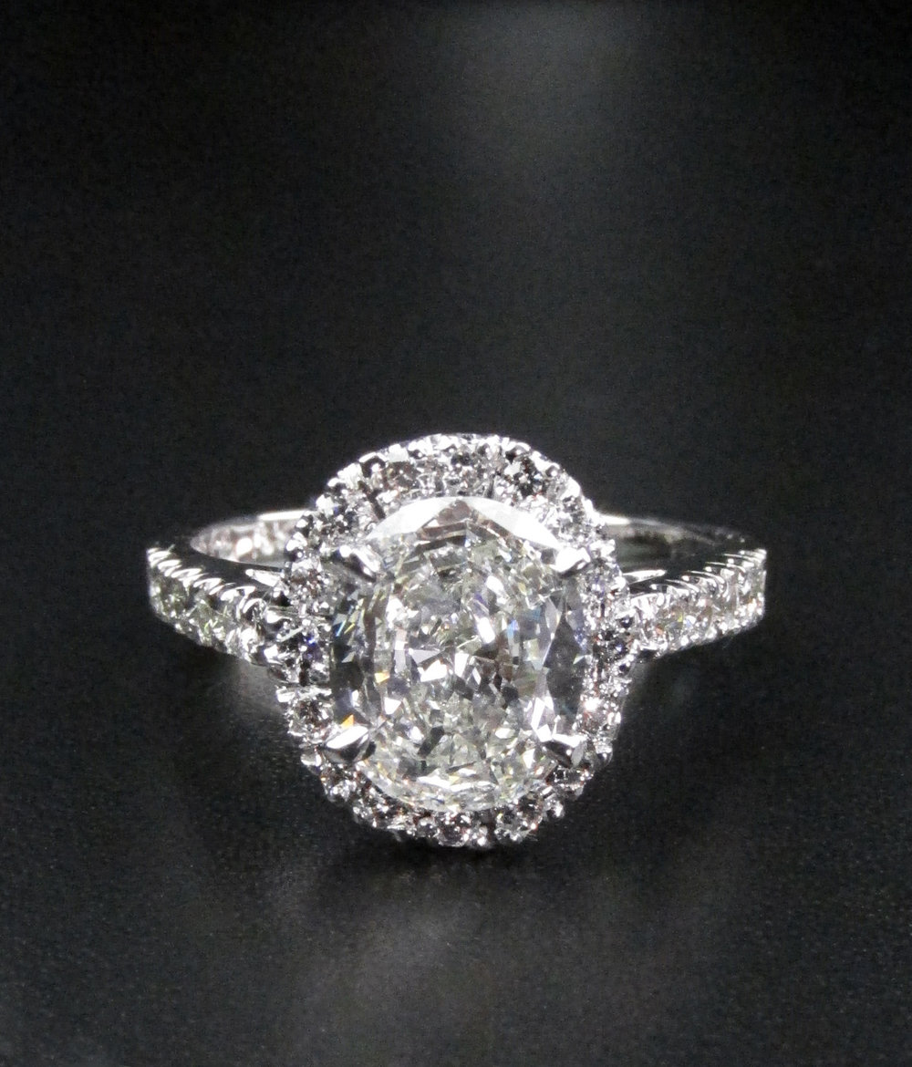 Halo Engagement Ring with Oval Diamond