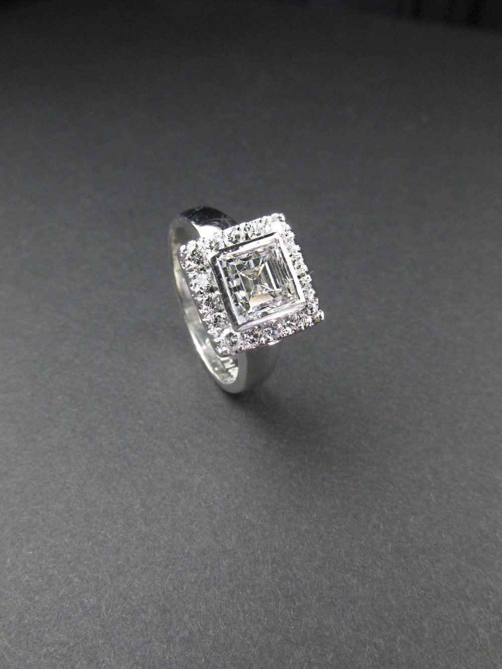 step_cut_square_diamond_ring_halo_platinum_redford_jewelers.jpg