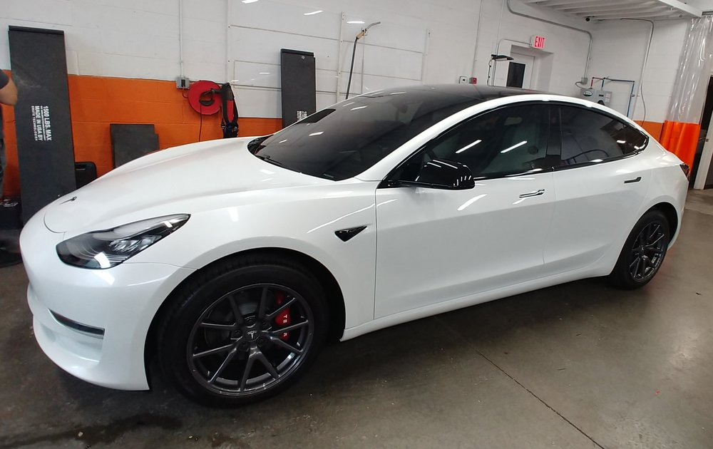 Beautifully modified Tesla Model 3 complete with 40% 3M Crystalline window film, PPF full frontal, Ceramic Pro, painted calipers and chrome blackout.