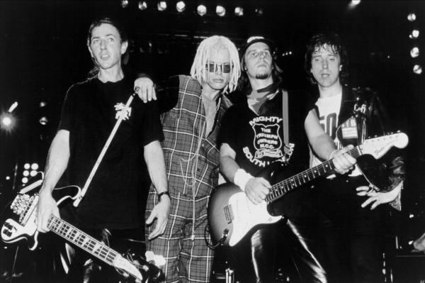 "The band in reunion mode; note singer's tasteful ""Predator in pyjamas"" stylings."