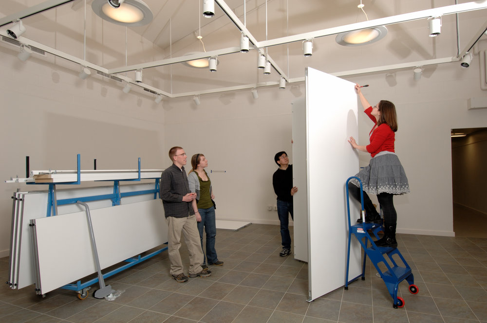 Students work on building an exhibit in CGP's gallery space