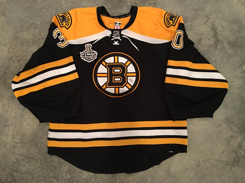 2011 Tim Thomas game worn home jersey with 2011 Stanley Cup Finals patch