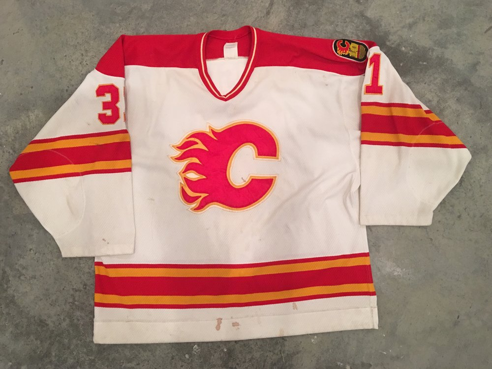 1990-91 Rick Wamsley game worn home jersey with Flames 10th anniversary patch
