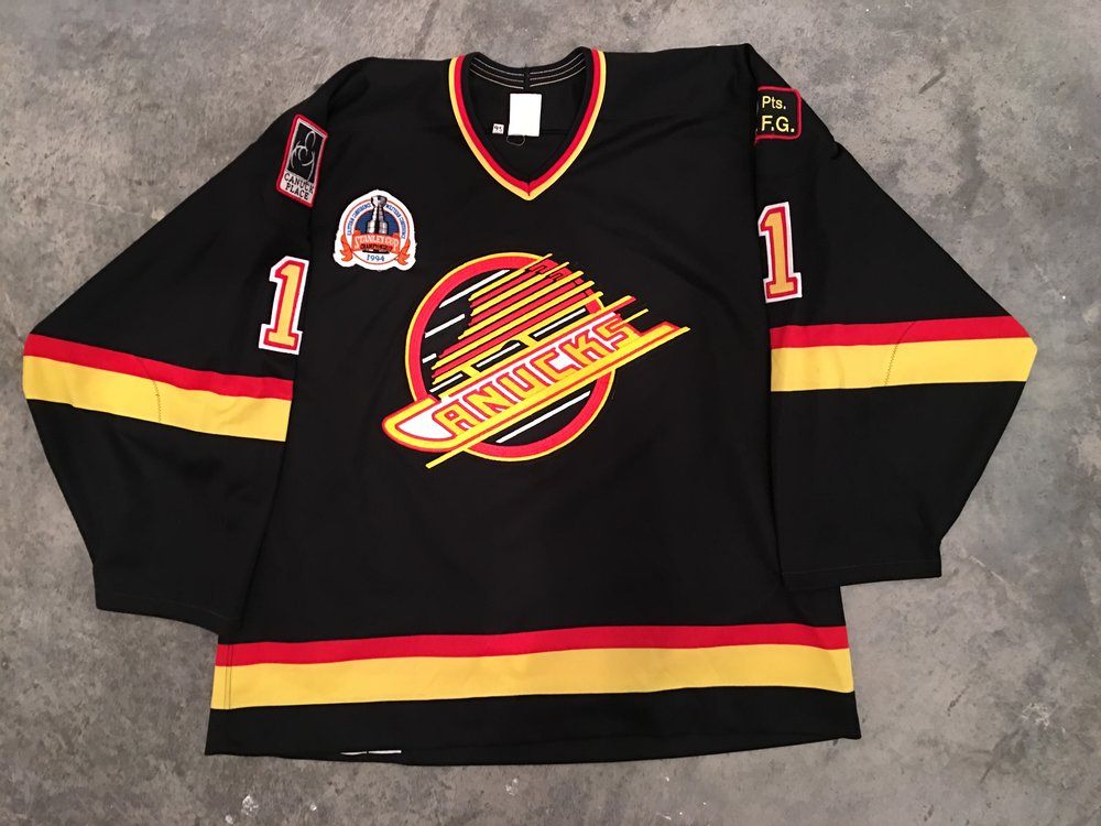 1993-94 Kirk McLean game worn road jersey with 1994 Stanley Cup Finals patch, 2Pts. FG Frank Grifiths memorial patch and Canucks Palace patch