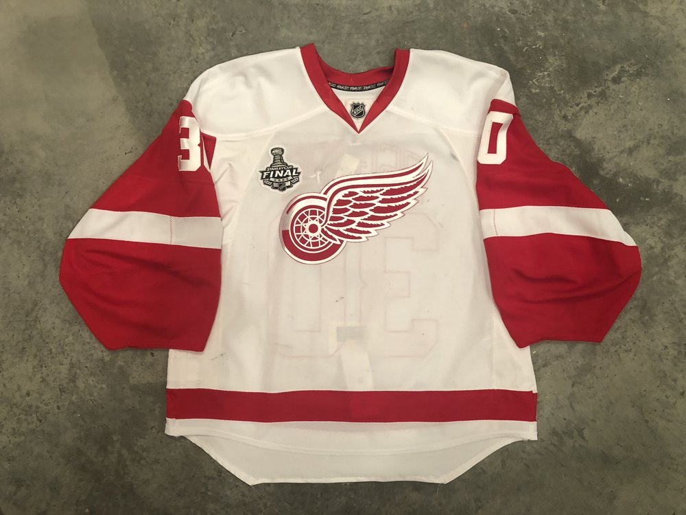 2009 Chris Osgood game worn road jersey with the 2009 Stanley Cup Finals patch
