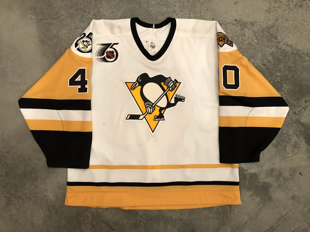 1991-92 Frank Pietranglo game worn home jersey with Badger Bob patch, Penguins 25th anniversary patch, and NHL 75th anniversary patch