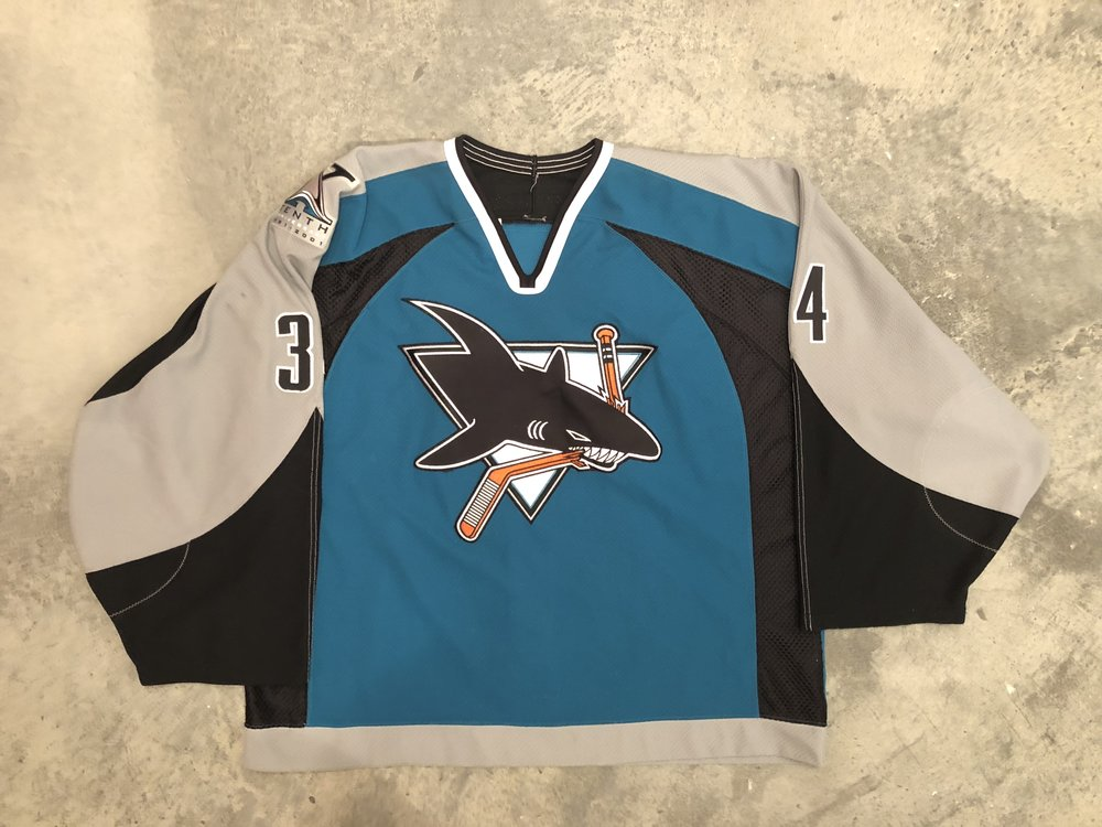 2000-01 Miika Kiprusoff game worn road jersey with Sharks 10th anniversary patch
