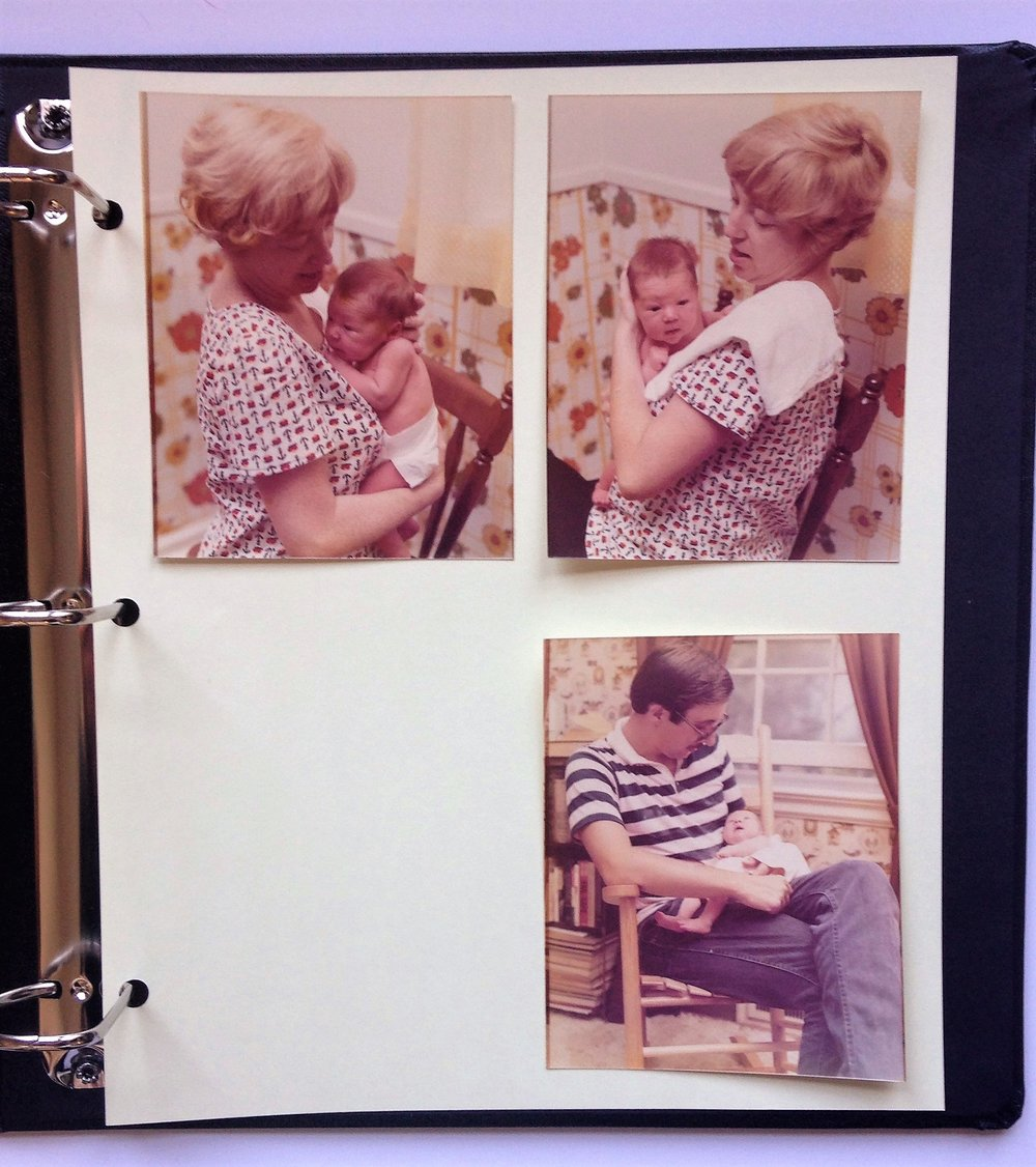 "An example of a page replicated in the new archival-quality album. Once I've decided on the positioning, I would secure the images to the page with mounting corners and write the caption, ""10 days old - August 28, 1977"" on the page."