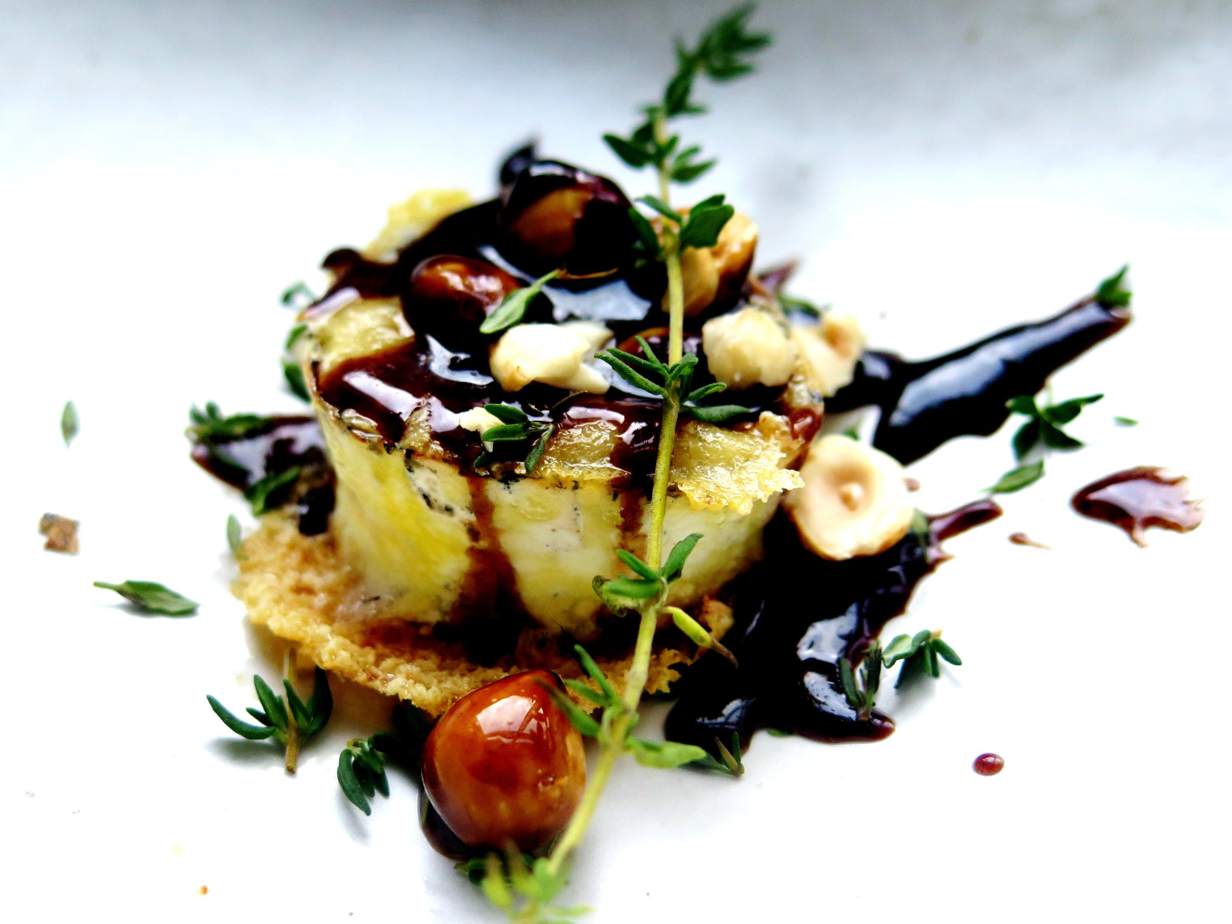 Crispy molten goat's cheese with caramelised, thyme-infused maple balsamic and toasted hazelnuts