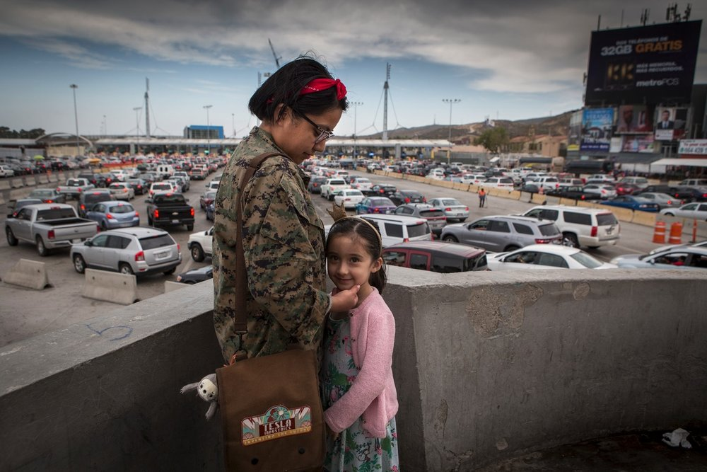 Pamela Pena, 25, with her niece Vistoria Cronel, 5. Pamela crosses the border at least once a week to study dentistry. She was born in San Diego but lives in Tijuana. Alexia Webster