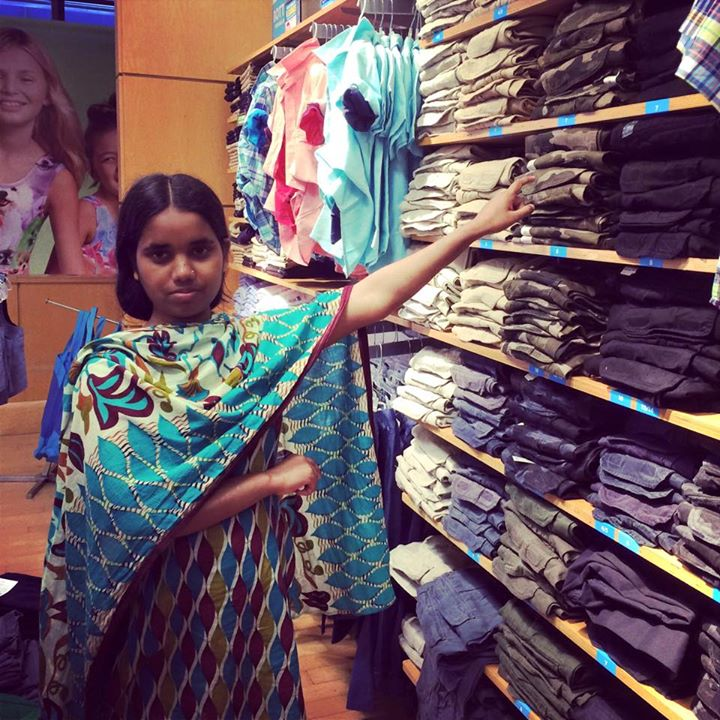 Mahinur Begum arrives at a Children's Place in Miami where she spotted the pants she sewed before the factory collapse.