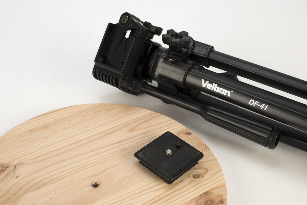 Attaching screw mounts to the bottom of objects allows you to use a tripod as an adjustable base. Here's a stool for photographers.