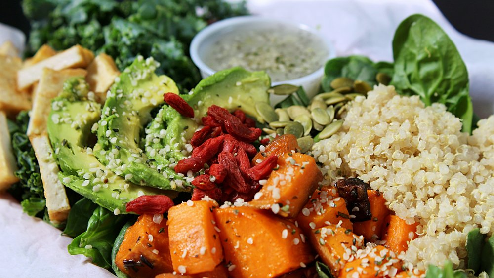 Hippie Bowl: Spinach, Kale, Tofu, Avocado, Quinoa, Roasted Sweet Potatoes, Pumpkin Seeds, Hemp Seeds, Goji Berries, With Homemade Poppy Seed Dressing