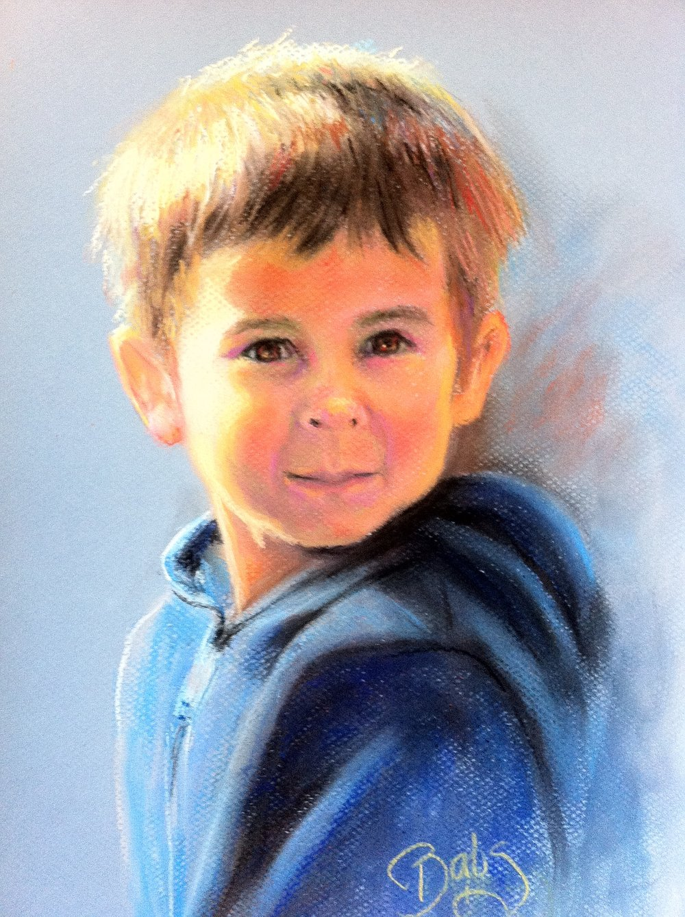 Little Brennan is standing outside with the sun on his face.  The pigment of pastel captures the sun on his face