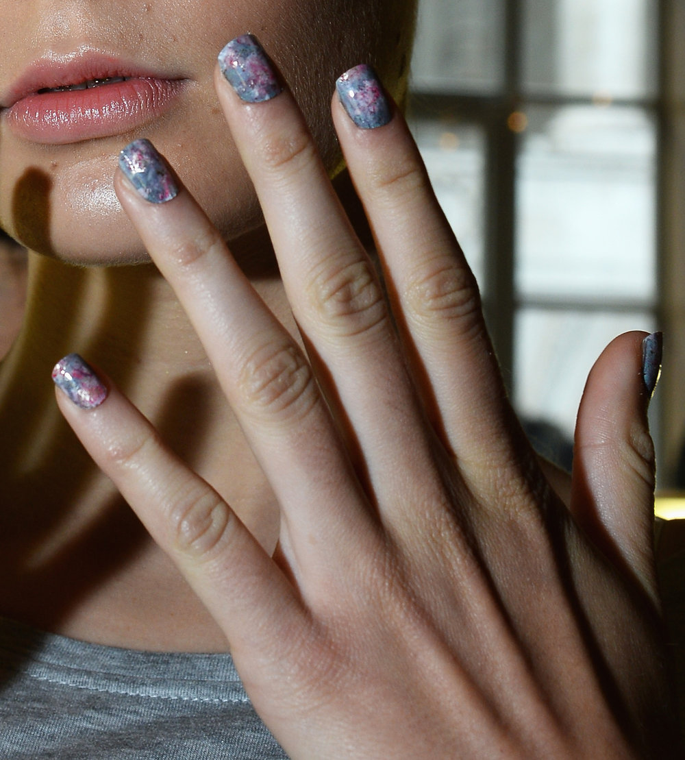 We can't get enough of these marbleized nails created by CND for the Michael van der Ham show in London!