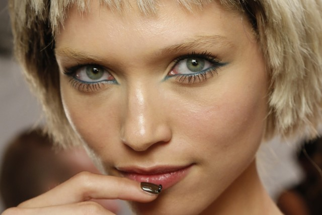 As another Fashion Week comes to a close, we'll leave you with this fresh look from Marc Jacobs… Loving the teal eyeliner by Francois Nars and the blonde bowl-cut wigs by Guido Palau for Redken.